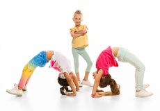 The kids dance school, ballet, hiphop, street, funky and modern dancers. On white studio background. Girl is showing aerobic and dance element. Teen in hip hop Royalty Free Stock Images