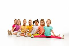 The kids dance school, ballet, hiphop, street, funky and modern dancers. On white studio background. Girl is showing aerobic and dance element. Teen in hip hop Royalty Free Stock Photography