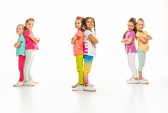 The kids dance school, ballet, hiphop, street, funky and modern dancers. On white studio background. Girl is showing aerobic and dance element. Teen in hip hop stock photography