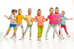 The kids dance school, ballet, hiphop, street, funky and modern dancers. On white studio background. Girl is showing aerobic and dance element. Teen in hip hop Stock Photo
