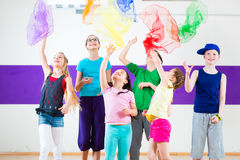 Kids in dancing class traninng with scarfs Royalty Free Stock Photos