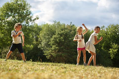 Kids dancing in summer. Kids dancing at the park in summer Stock Photo