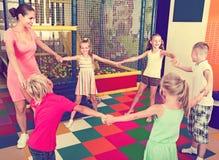 Kids dancing with teacher in  school class. Active kids dancing with teacher in elementary school class Stock Photos