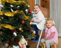 Kids decorate fir for Christmas Stock Photos