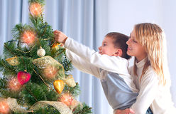 Kids Decorating Christmas Tree Stock Photography