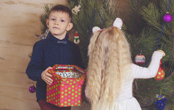 Kids Decorating Christmas Tree with Colored Balls Stock Images