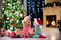 Kids decorating Christmas tree Stock Photography