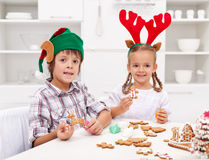 Kids decorating gingerbread christmas cookies Stock Photography