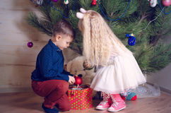 Kids Decorating a Home Christmas Tree with Balls Stock Photos