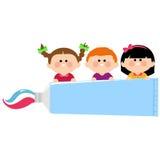 Kids dental hygiene holding toothpaste Stock Image