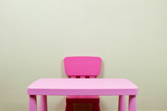 Kids desk and chair against the wall Stock Photo