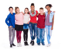 Kids with different clothes standing together. Isolated on white background Royalty Free Stock Images