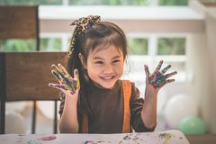 Kids with painted hand in art classroom. Kids with dirty painted hand in art classroom royalty free stock photo