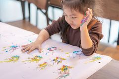 Kids with painted hand in art classroom. Kids with dirty painted hand in art classroom stock photos