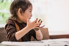 Kids with painted hand in art classroom. Kids with dirty painted hand in art classroom royalty free stock image