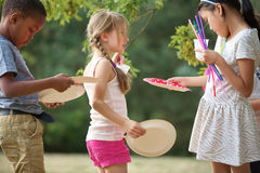 Kids distribute plates at a party Royalty Free Stock Image
