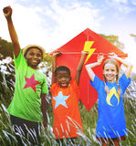 Kids Diverse Playing Kite Field Young Concept Stock Images