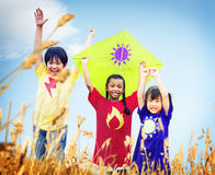 Kids Diverse Playing Kite Field Young Concept Royalty Free Stock Photos