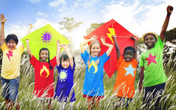 Kids Diverse Playing Kite Field Young Concept stock photo