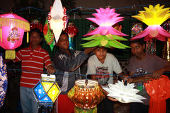 Kids Diwali Shop. Poor kids from India selling traditional lanterns in a streetside shop on the occassion of Diwali festival in India Stock Images