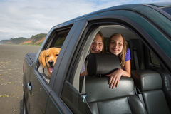 Kids and a dog in the back seat Royalty Free Stock Photography