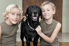 Kids with Dog at Home Royalty Free Stock Photos