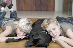 Kids with Dog at Home Stock Image