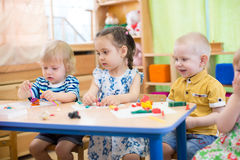 Kids doing arts and crafts in day care centre Royalty Free Stock Photo