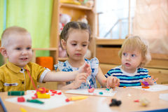 Kids doing arts and crafts in day care kindergarten Stock Image