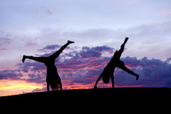 Kids doing cartwheels. stock photography
