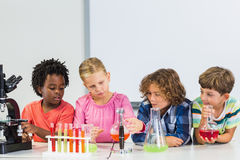 Kids doing a chemical experiment in laboratory. At school Royalty Free Stock Photos