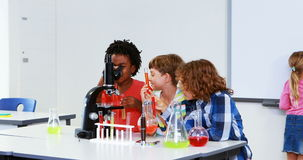 Kids doing a chemical experiment in laboratory stock video