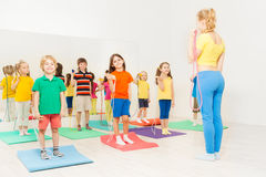 Kids doing gymnastic exercises using jumping rope Royalty Free Stock Photo