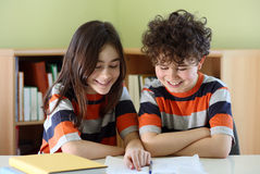Kids doing homework stock images