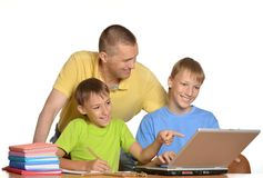 Kids doing homework with father Stock Photo