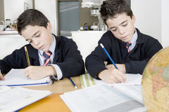 Kids doing homework at home Royalty Free Stock Photography