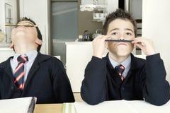 Kids doing homework at home Stock Photos
