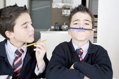 Kids doing homework at home Royalty Free Stock Photo