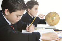 Kids doing homework at home royalty free stock photos