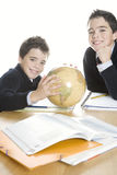 Kids doing homework at home Stock Photography