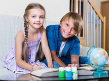 Kids doing ordinary homework together Royalty Free Stock Photography