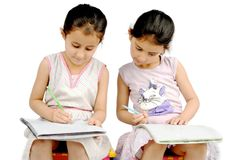 Kids doing their homework. Stock Images