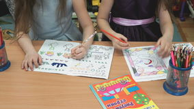 Kids draw the pictures in the copybooks stock footage