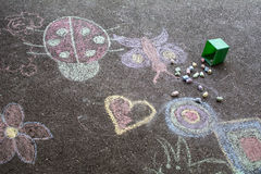 Kids drawing on asphalt Royalty Free Stock Photo