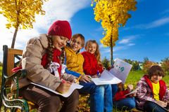 Kids drawing autumn pictures royalty free stock photos