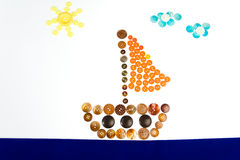 Kids drawing of a boat floating made from buttons Royalty Free Stock Images