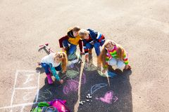Kids drawing with chalk Royalty Free Stock Image