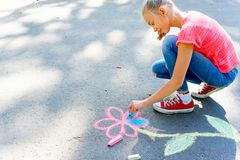 Kids drawing with chalk. On a playground Royalty Free Stock Photos