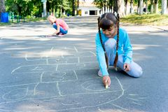 Kids drawing with chalk. On a playground Royalty Free Stock Photography
