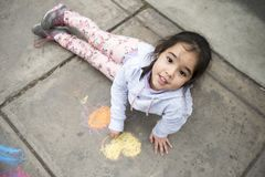 Kids Drawing with Chalk on Sidewalk stock photography
